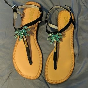 Carlos Santana palm tree sandals